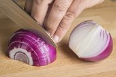 Chef Choppig A Red Onion With A Knife