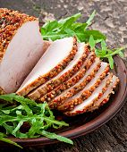 Baked pork decorated with arugula leaves