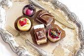 mini bavarian cream dessert with vintage silverware