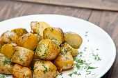 Young Boiled Potatoes With Dill In Oil In White Plate
