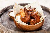 Fried Chicken Wings In Wooden Bowl
