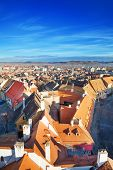 stock photo of sibiu  - Rows of red roofs and horizon with blue sky in beautiful Sibiu - JPG