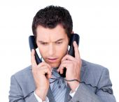 Young Businessman Tangle Up In Phone Wires