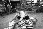 Old woman selling salted fish
