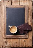 Coffee Cup With Chocolate On Vintage Slate Chalk Board