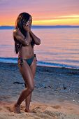 Beautiful Black African American Woman Posing On The Beach At Sunset