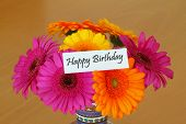 Happy Birthday card with colorful gerbera daisies bouquet