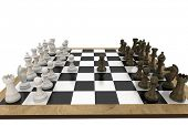 Chess pieces facing off on board on white background