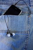 Black phone with headphones in the pocket