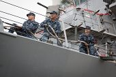 STATEN ISLAND, NY - MAY 21: Sailors aboard the guided-missile destroyer USS Cole (DDG 067) tend the
