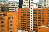 white and orange brick buildings in city