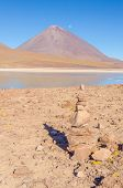 Cairn (Quechuan shrine to the indigenous Inca goddess Pachamama), Laguna Verde and Licancabur volcan