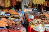 Man sells dry fishes