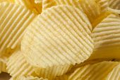 pic of grease  - Unhealthy Crinkle Cut Potato Chips Ready to Eat - JPG