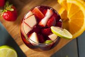 stock photo of sangria  - Homemade Delicious Red Sangria with Limes Oranges and Apples - JPG