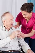 picture of hospice  - Disabled man drinking water in a hospice - JPG