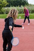 Young Girls Playing In Badminton