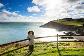 Irish Landscape. Coastline Atlantic Coast County Cork, Ireland. Woman Walking