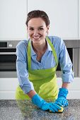 Smiling Housewife Cleans The Worktop