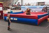 Young Cowboy And Mechanical Bull At Rocking The Park Event In Milan, Italy