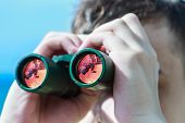 picture of binoculars  - man is looking to the binocular on sea - JPG