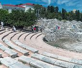 Visiting Tourists Ancient Amphitheater In Chersonesos