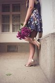 Fashionable Woman Wearing A Blue Floral Print Dress, Gold Shoes