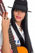 Young brunette woman with black hair with a guitar. Girl, twenty-six years.