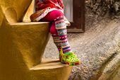 Little Girl Sitting On Stairs