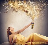stock photo of blow-up  - Rich luxury women blows up the champagne - JPG