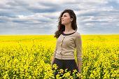 woman portrait in yellow flower field
