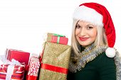 Beautiful Christmas Woman Is Holding Gift In Studio. Isolated