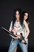 picture of gun shot wound  - two girls with weapon on black background - JPG