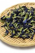 dried butterfly pea flowers on bamboo basket