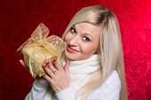 A Girl In A White Sweater With A Gift Bow With Bandaged Looking At The Camera.