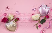 Valentine's day card  with hearts and flowers on the pink background