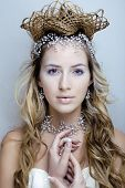 stock photo of fairy  - beauty young snow queen in fairy flashes with hair crown on her head close up - JPG