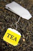 Tea Bag Over Dried Tea Leaves Background