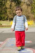 image of hopscotch  - Small child playing a hopscotch game in spring - JPG