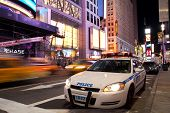 Police Car On Times Square New York At Night