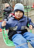 image of funfair  - Children on chain swing merry - JPG
