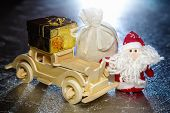 Santa Claus With Wooden Car, Gift Box And Sack