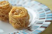 foto of baklava  - Closeup of birds nest baklava dessert with peanuts - JPG