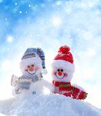 Happy snowmen .Christmas background