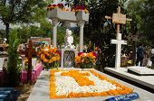 Grave decorated with flowers at the Oaxaca General Cemetery in Oaxaca City, Mexico