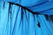 foto of tarp  - a picture of a stretched blue tarp - JPG