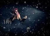 picture of witchcraft  - Beautiful witch making witchcraft over winter background - JPG