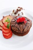 Hot chocolate pudding with ice-cream and fruits, close-up