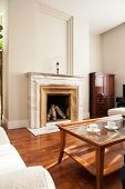 Traditional Fireplace In Luxury Parlour