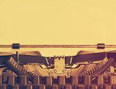 obsolete typewriter with paper, retro film filtered, instagram style